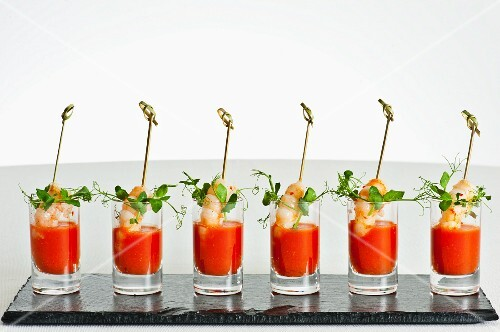A row of gazpacho shots