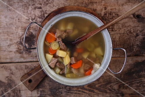 Vegetable soup with beef in a pot