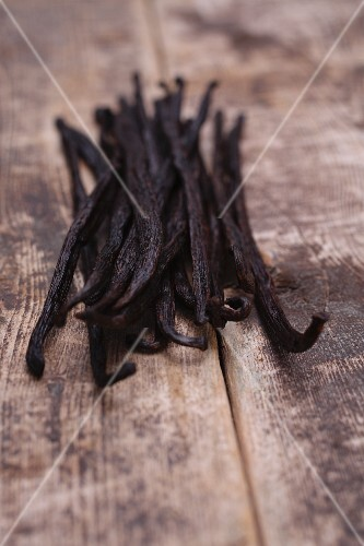 Vanilla pods on wooden background