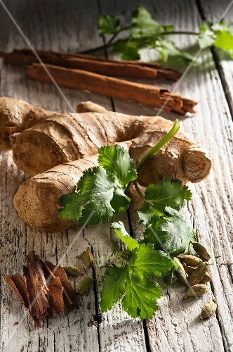 Ginger, cinnamon sticks, cardamom pods and fresh coriander