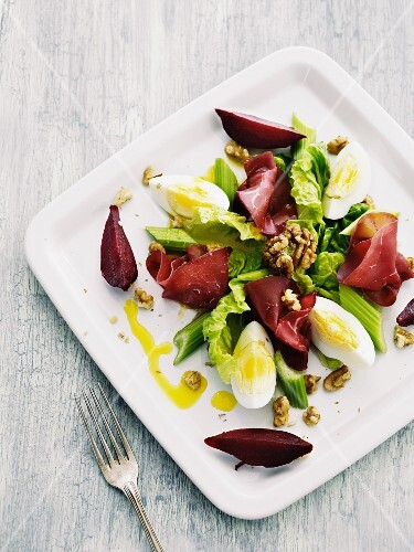 A salad of bresaola, egg, walnuts, celery and beetroot