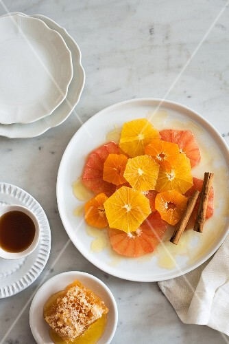 Citrus fruit salad with honey and cinnamon sticks