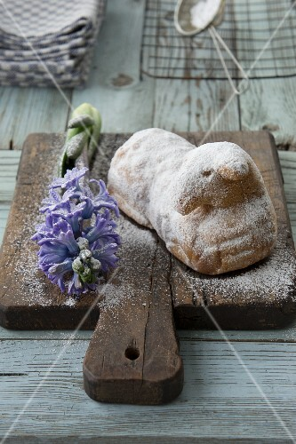 A sweet Easter lamb with hyacinths on a chopping board
