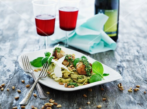 Fish balls with tagliatelle, basil pesto, Parmesan cheese and pine nuts