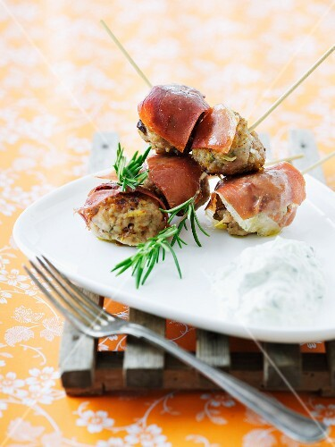 Meatballs with rosemary wrapped in ham