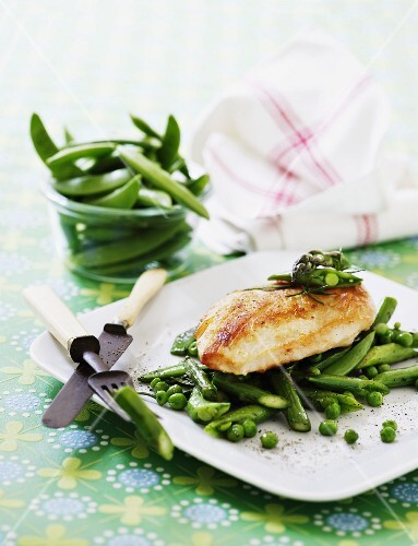 Chicken breast on a bed of green vegetables