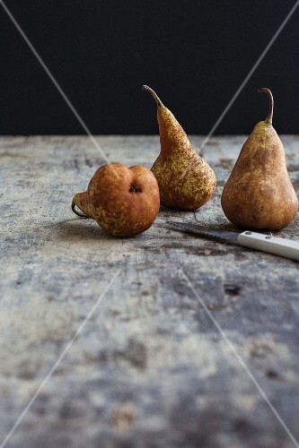 Three pears with a knife