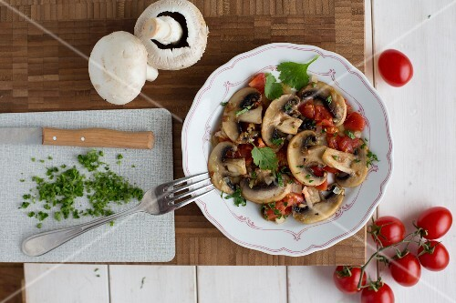 Fried mushrooms with tomatoes and parsley