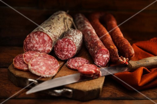 Various types of salami on a chopping board