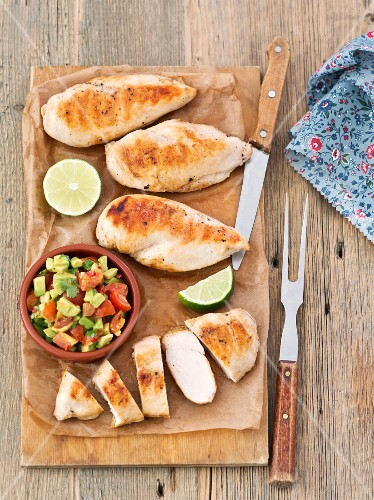 Grilled chicken breast with tomato and avocado salsa