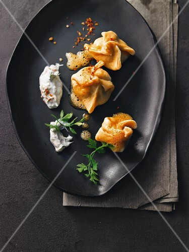 Pasta and mushroom dumplings with dill yogurt and chilli butter