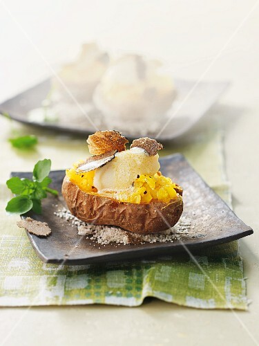 A baked potato with truffles