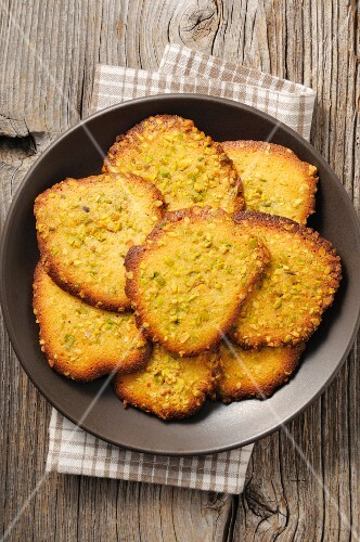 Tuiles with chopped pistachios