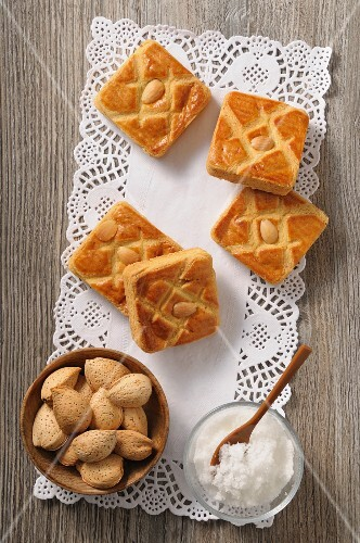 Almond slices, sugar and almonds on a doily