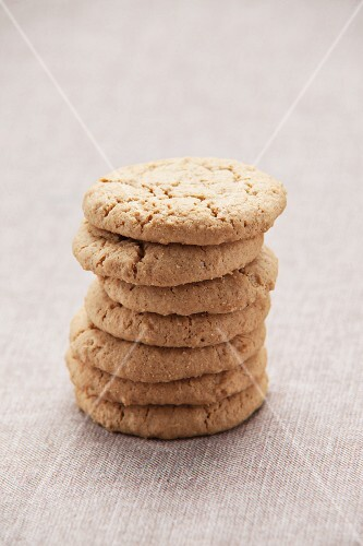 A stack of cookies on a tablecloth