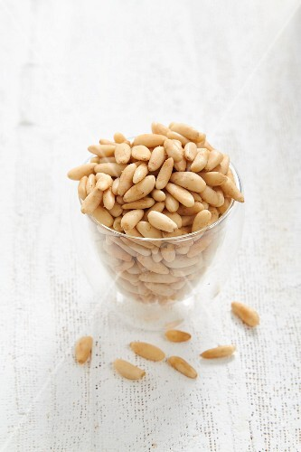 A glass of pine nuts