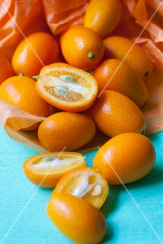 Several kumquats, whole and halved