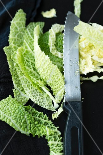 Sliced savoy cabbage with a knife