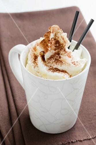 Viennese coffee with cream and cocoa powder