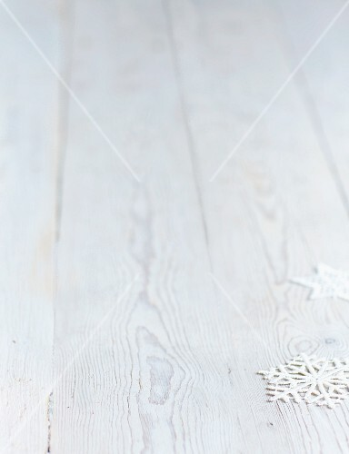 Snowflakes on a white wooden surface (Christmas)