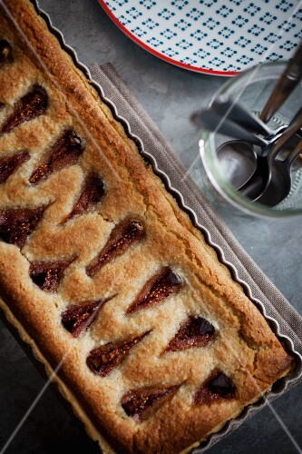A rectangular fig and frangipan tart in a baking tray (seen from above)