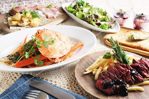 Crab with pasta, roast beef with chips and a mixed leaf salad