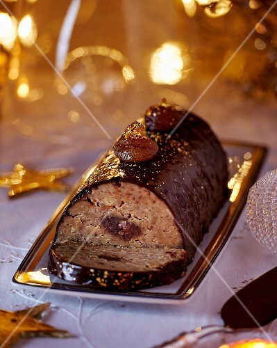 A Christmas chestnut roulade with chocolate glaze and gold leaf