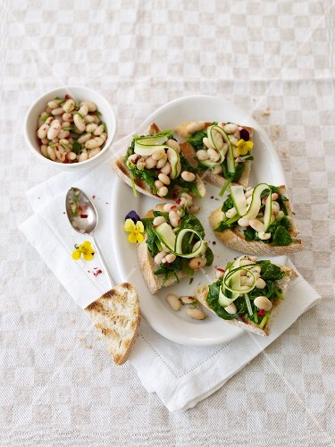 Crostini topped with beans and spinach