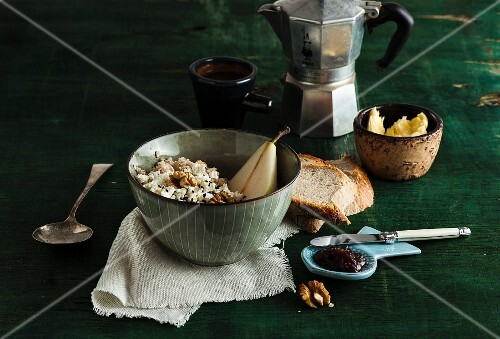Muesli with pears and walnuts, bread, jam and coffee
