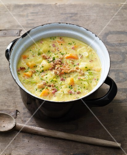 Potato soup with carrots, leek and diced ham
