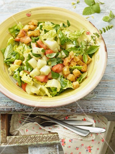 A summer salad with tomatoes and melon