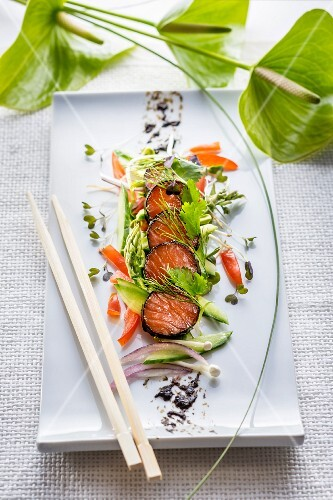 Salmon wrapped in nori with herbs and vegetables