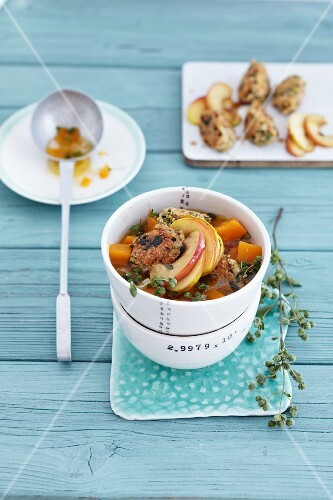 Pumpkin stew with amaranth dumplings and fried apple slices