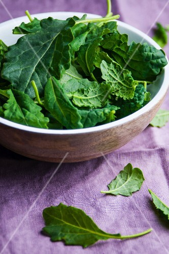 Young kale leaves in a bowl