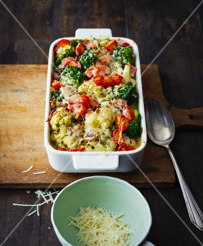 Cauliflower and broccoli bake with cherry tomatoes and lean ham