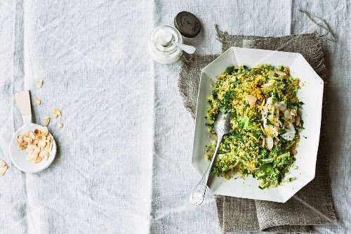 Broccoli and couscous with lemon yoghurt and flaked almonds