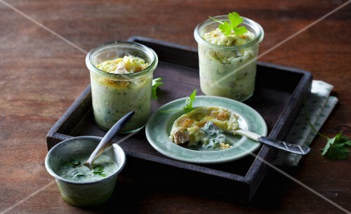 Salmon trout pie served in glasses with a green sauce