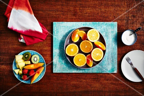 Oranges, halved and in wedges, and fresh fruit salad