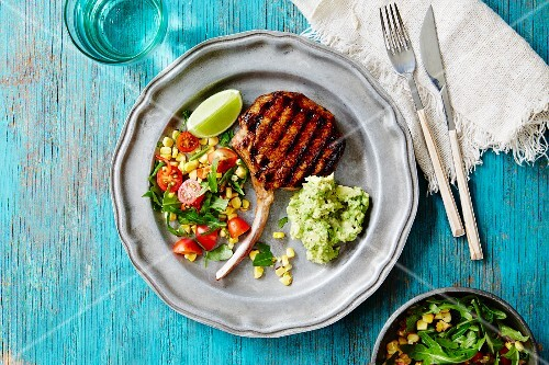Grilled pork chop with salad and guacamole (Mexico)