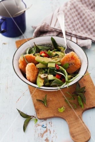 Prawn cakes with an avocado and cucumber salad