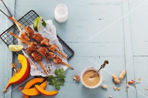 Turkey skewers with a peanut sauce and Hokkaido pumpkin wedges