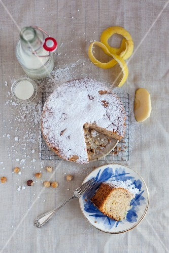 Apple and hazelnut cake with icing sugar