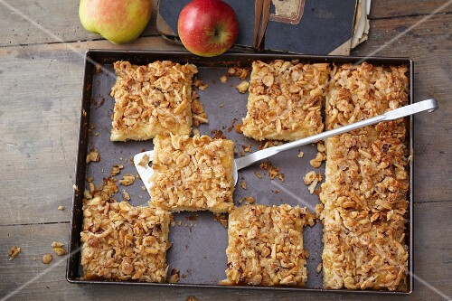 Apple cake topped with oats and nuts