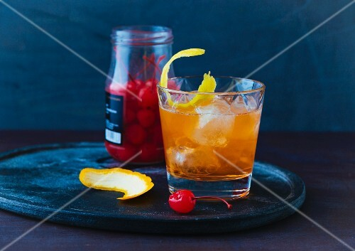 An Old Fashioned with a cocktail cherry