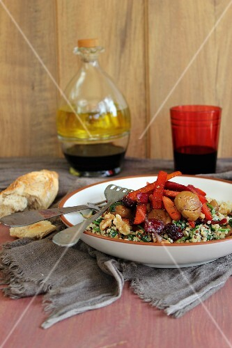 Quinoa and spinach salad with glazed carrots, chestnuts and dried fruit