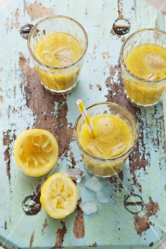 Vitamin smoothies made from kiwis, oranges and mandarins
