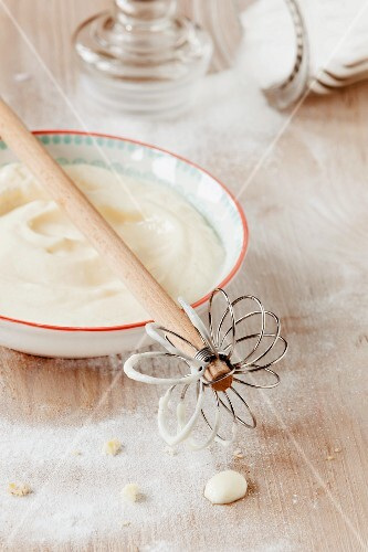 Quark for cheesecake with a whisk and sugar