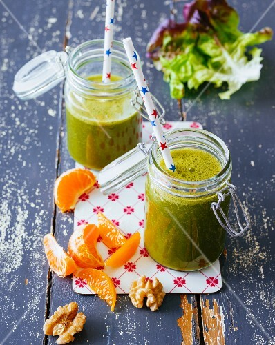 Mandarin and passion fruit smoothie with walnuts, oak leaf lettuce and rocket