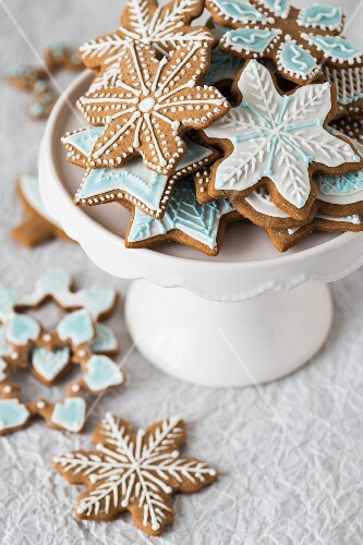Christmas gingerbread biscuits with coloured icing on a cake stand