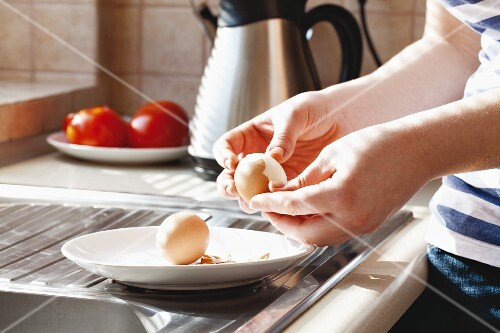 Hard-boiled eggs being shelled